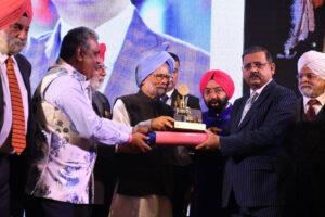 Jewel of Punjab award being given by Ex-PM India, Dr Manmohan Singh